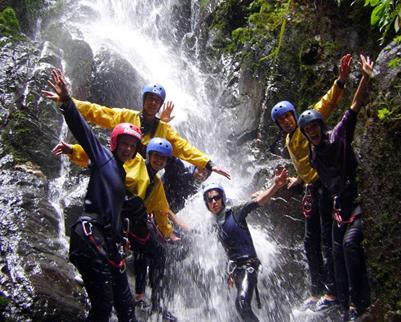 Outdoor Recreation - students in waterfall