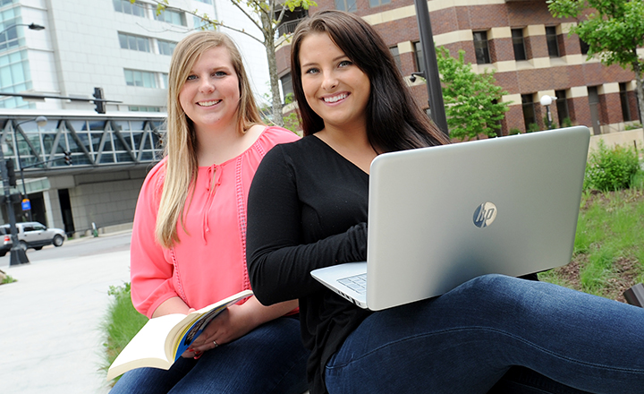 Two DMACC Students Sitting Outside