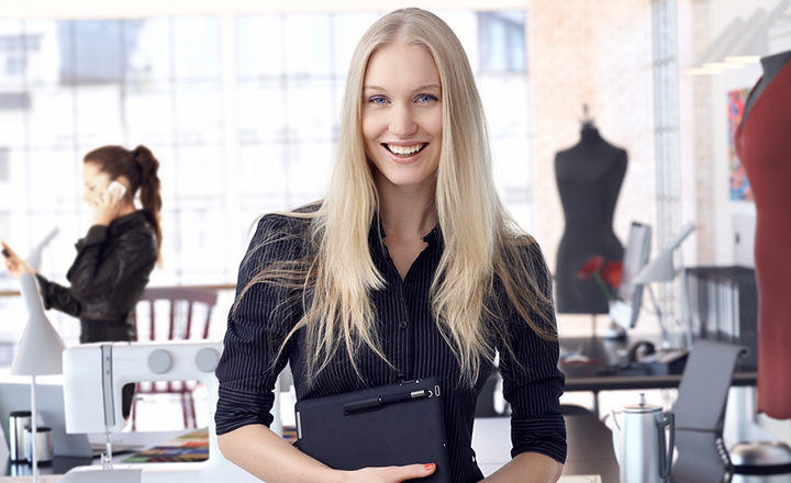 Woman Holding Tablet in Fashion Shop