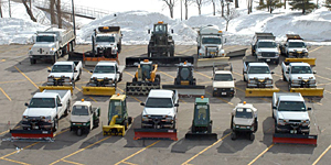 Snow plows in parking lot