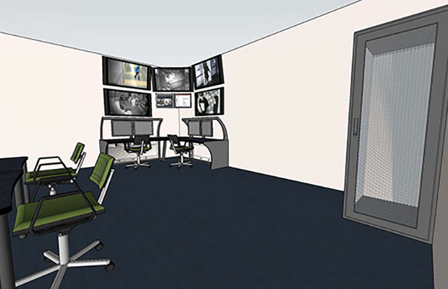 Monitor room shows desks and multipanel computer center