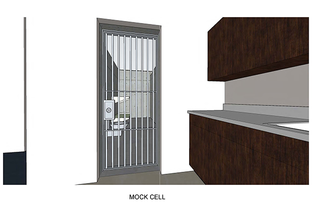 Mock cell shows barred door looking into the cell with a counter off to the right outside the door.