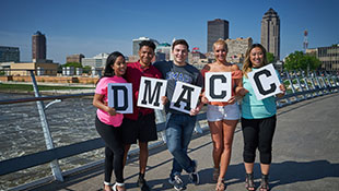 DMACC Students holding DMACC words