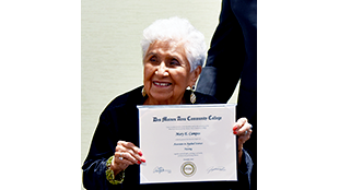 Mary Campos holds her diploma