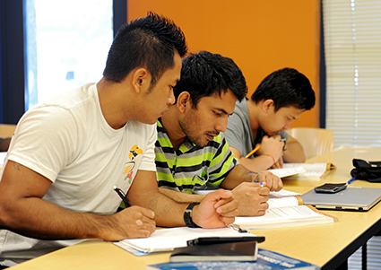 three DMACC students in a classroom