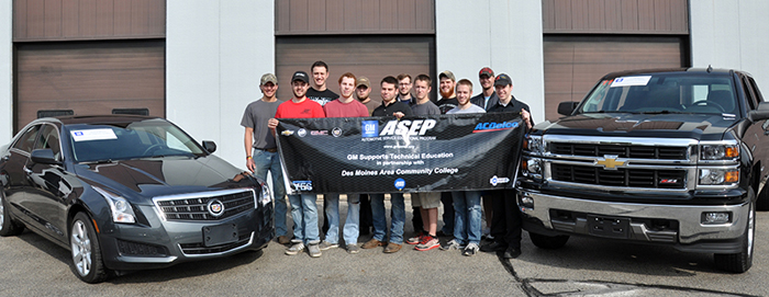 DMACC Automotive Students with one of the donated cars from General Motors