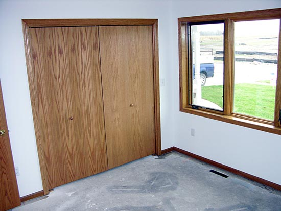 Bedroom walls, window, and closet doors