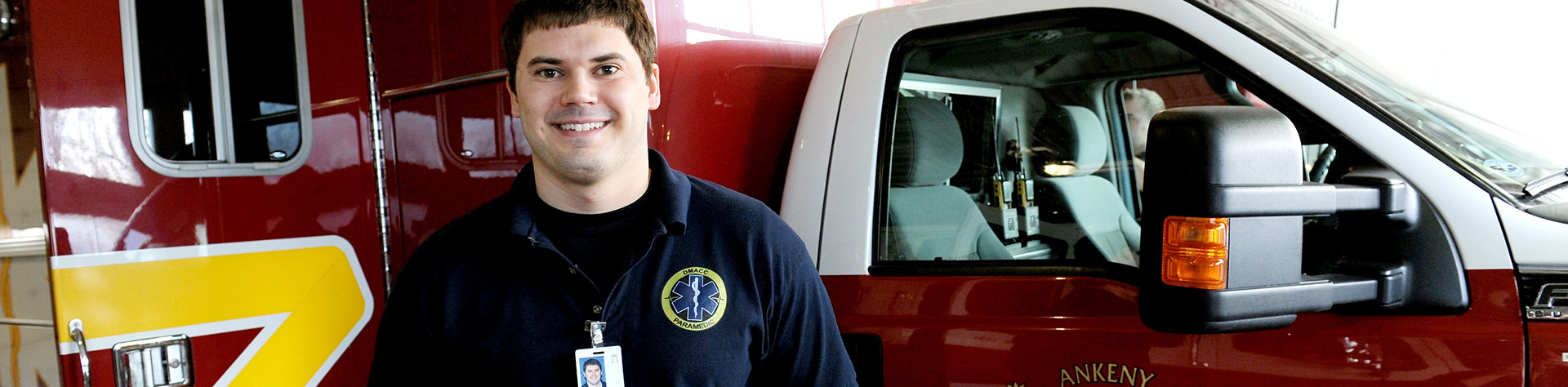 DMACC student standing next to an ambulance