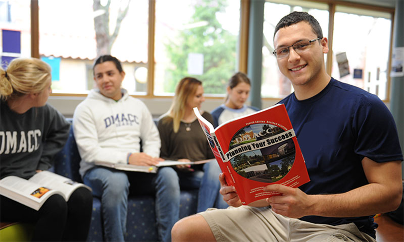 Student with DMACC Success Brochure